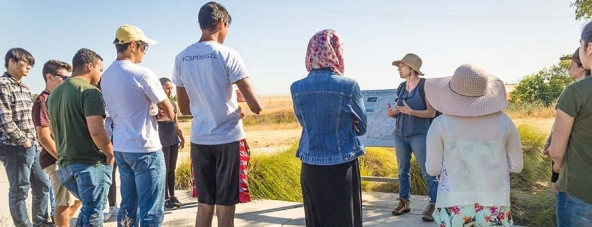 Image of people listening to a tour guide